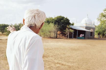 Padri Showing Pilgrims Baba's Samadhi
